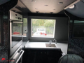 coach with a kitchen on board to hire with a driver