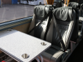 luxury coach with fixed in tables to hire